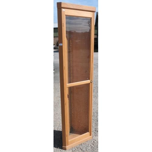 66 - Modern light oak free standing corner unit enclosed by single glazed door (height 194cm)...
