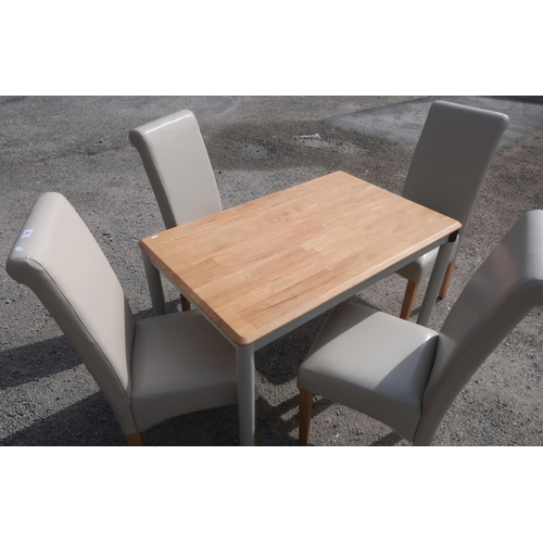 70 - Light wood with painted base rectangular kitchen table and set of four cream leather dining chairs w...