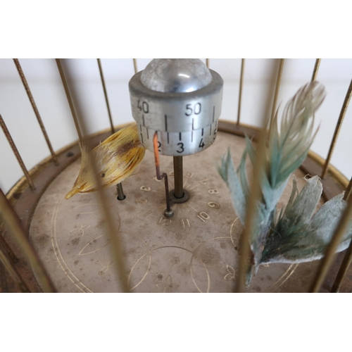 77 - Bird cage clock with wind up action (height 20cm)...