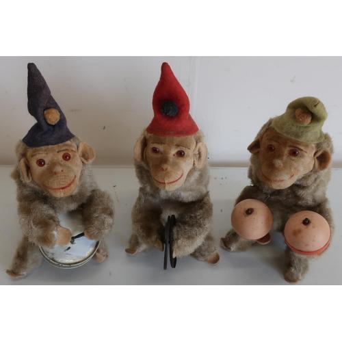 78 - Set of three clockwork West German made musical monkeys (height 22cm)...