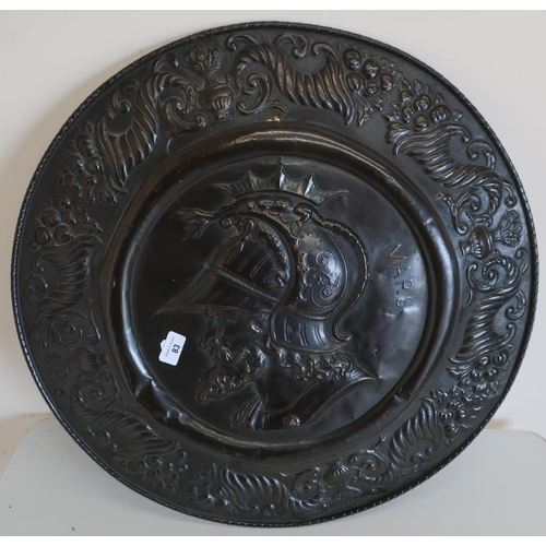 83 - Pressed metal bronze effect shield with head and shoulder central portrait figure of Mars the God of...