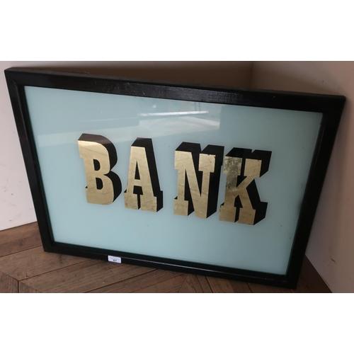 87 - Ebonised framed 'Bank' glass sign (54cm x 74cm)...