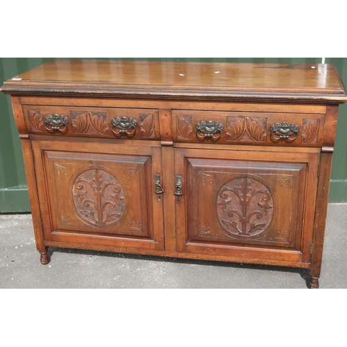 91 - Late Victorian mahogany sideboard with two drawers above two cupboard doors with carved and panelled...