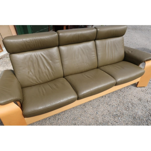 93 - Stressless three seat reclining leather sofa with beech light wood supports (width 230cm)...
