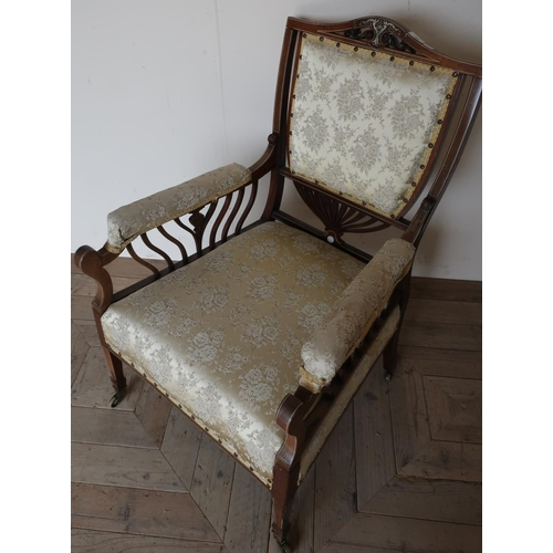 99 - Victorian rosewood and ivory inlaid armchair with upholstered seat, back and arms...