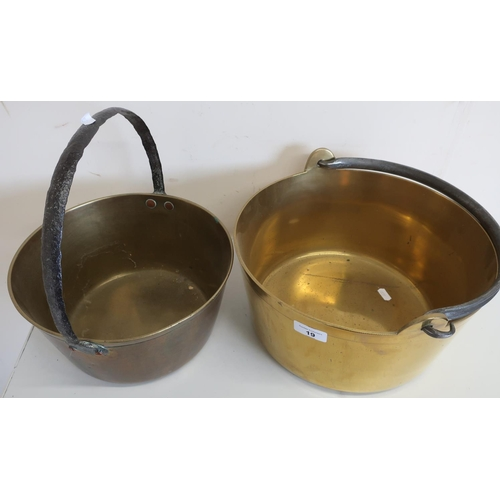 19 - Large brass jam pan with swing handle (diameter 33cm) and another similar...