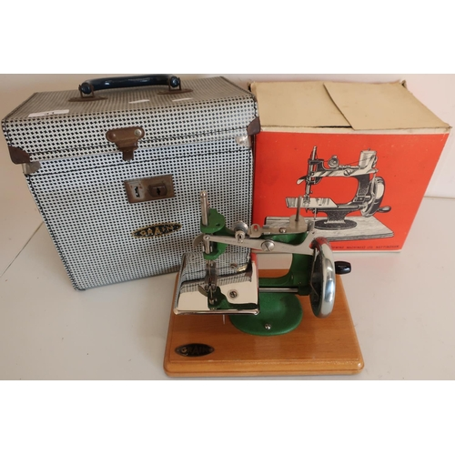 41 - Cased Grain mini hand operated sewing machine with original cardboard box and outer case...