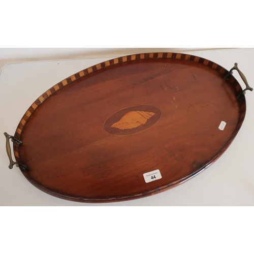 44 - Edwardian mahogany inlaid oval twin handled tray with raised sides and central inlaid shell pattern ...