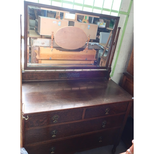 115 - Early - mid 20th C oak dressing chest with raised bevelled edge mirror back, above two short drawers...
