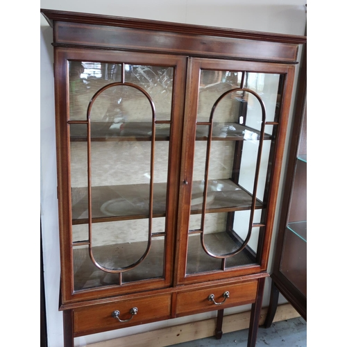 94 - Edwardian mahogany inlaid cabinet enclosed by two glazed doors with two drawers to the base, on squa...