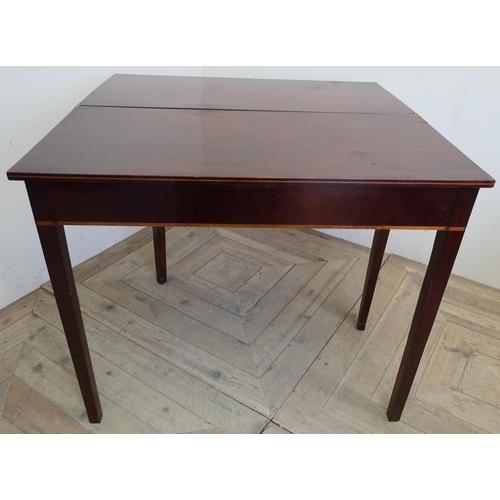 156 - 19th C mahogany rectangular fold over tea table with inlaid detail and square tapering supports (89c...