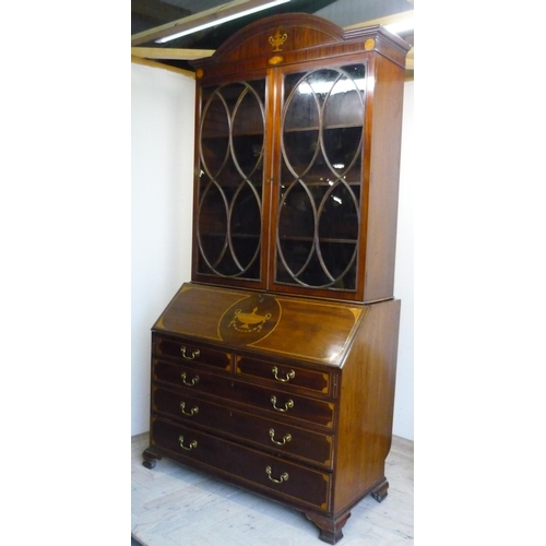127 - 19th C mahogany bureau bookcase with arched top above two glazed cupboard doors with shelved interio...