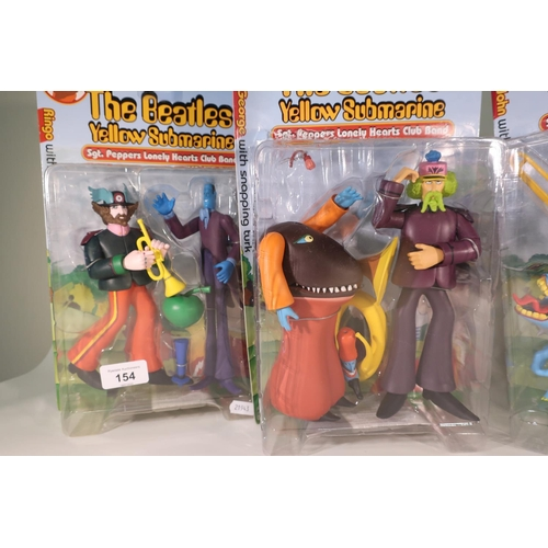 154 - Four McFarland Toys boxed and sealed The Beatles Yellow Submarine, Sergeant Pepper's Lonely Hearts C...