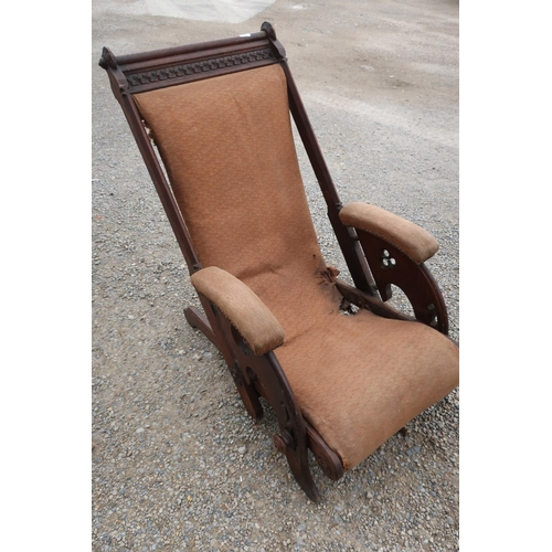 166 - Unusual late Victorian oak Gothic style reclining armchair with carved detail and upholstered seat a...
