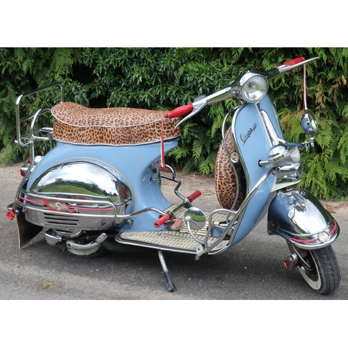 320 - 1959 Vespa 125CC scooter in blue and cream finish with leopard print seat and wheel cover, with vari...