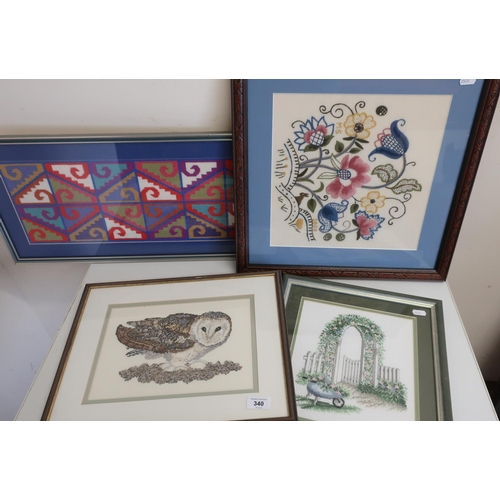 340 - Group of four embroidered and wool work pictures...