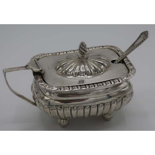 12 - Silver hallmarked salt with hinged lid and associated spoon with blue glass liner on four bun feet (...