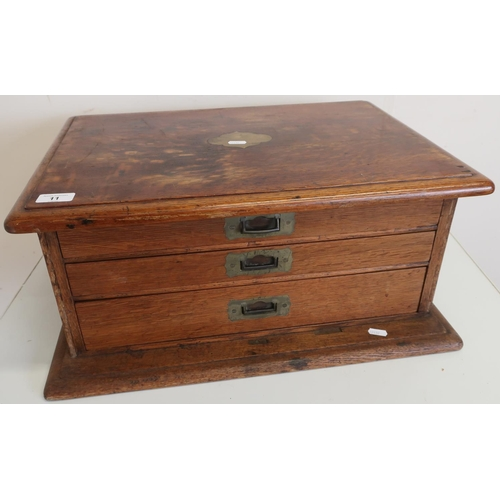 11 - Oak table top three drawer canteen with inset brass handles (empty) (66cm x 43cm x 26cm)...
