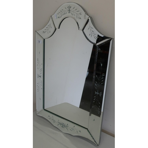 12 - Modern Venetian type wall mirror, the raised side panels with etched detail (51cm x 79cm)...