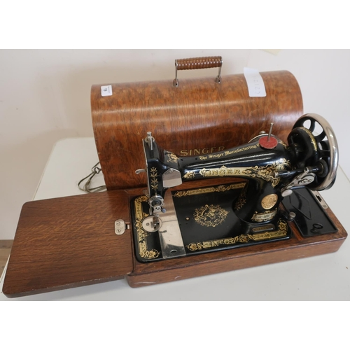 19 - Cased Singer sewing machine...