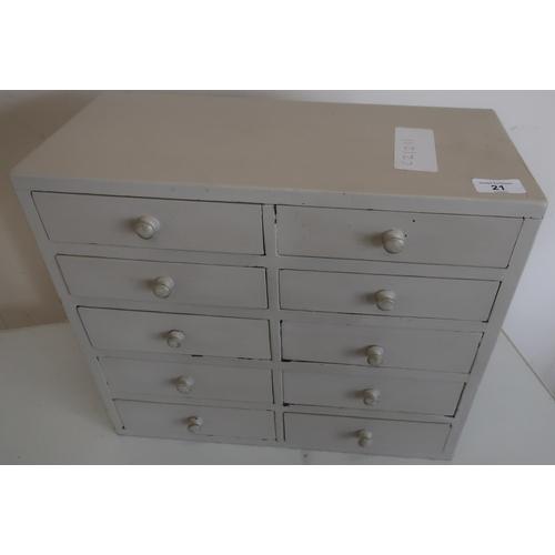21 - Painted desk top multi-bank of ten short drawers (42.5cm x 19.5cm x 36cm)...