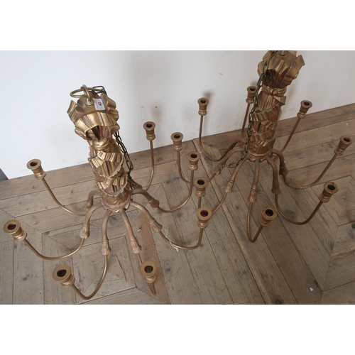 43 - Pair of Regency style gilt wood and metal eight branch centre hanging chandeliers (height 65cm)...