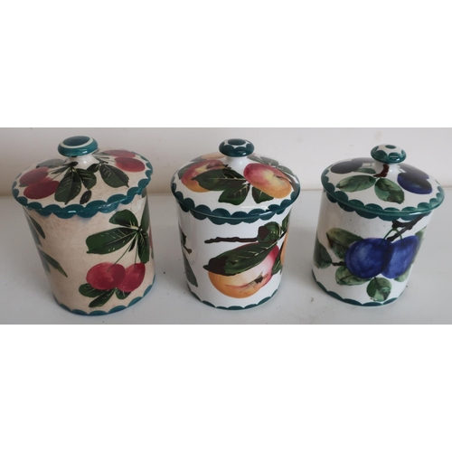 44 - Three Wemyss Pottery preserve jars with lift off lids, decorated with plums and apples (approx heigh...
