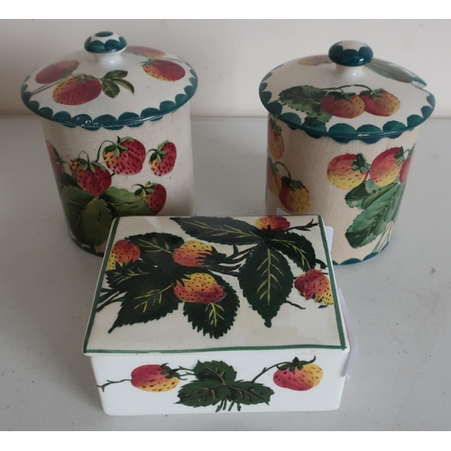 45 - Two Wemyss Pottery strawberry pattern preserve jars (approx height 12.5cm) with signed and impressed...