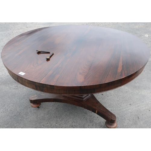 48 - Victorian rosewood breakfast table circular tilt top on tapering column and three bun turned feet (d...