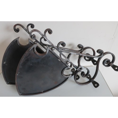 37 - Pair of wrought steel wall mounted hanging shield shaped double sided signs (approx 53cm x 64cm)...