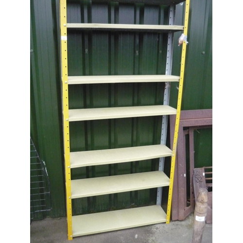 21 - Galvanised shelving unit with seven shelves...