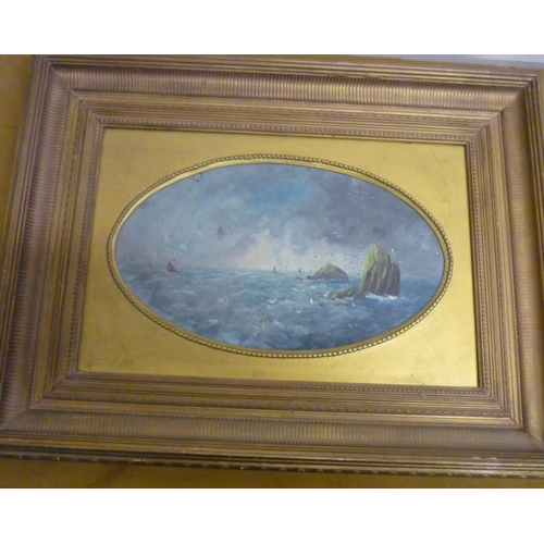 23 - English school 19th C, a stormy seascape with guls, oils on panel, signed with initials MY, oval (37...