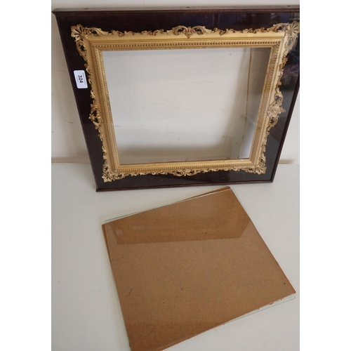 15 - 19th C gilt wood and gesso picture frame with pierced and scroll cresting, in velvet lined rosewood ...
