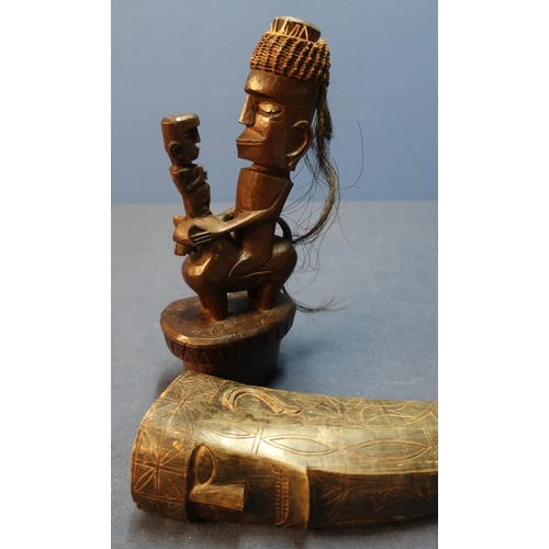 48 - Late 19th C carved Batak Sumatran  tribal horn flask, the horn with engraved detail with carved figu...