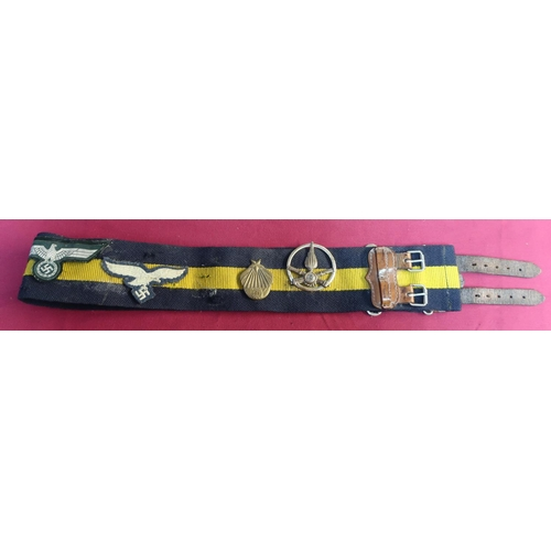 3 - Two stable belts, one with brass buckle, a Russian brass belt buckle and various badges mounted to t...