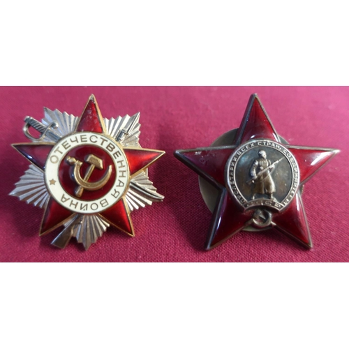 4 - Two Russian Soviet military cap badges including red enamel badge with central figure on an Infantry...