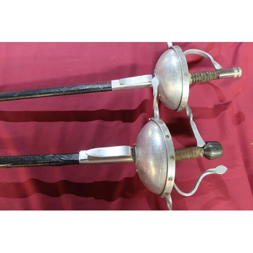 25 - Pair of reenactors style Rapier swords with cut basket hilts and scabbards, the tri-form blades mark...