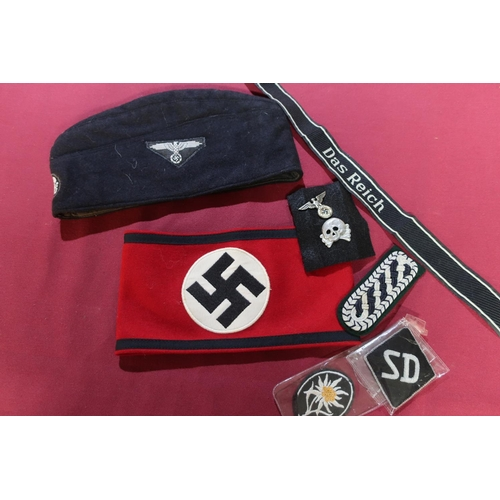 39 - Large collection of reproduction German WW2 badges, arm bands, side caps , belts , medals etc...