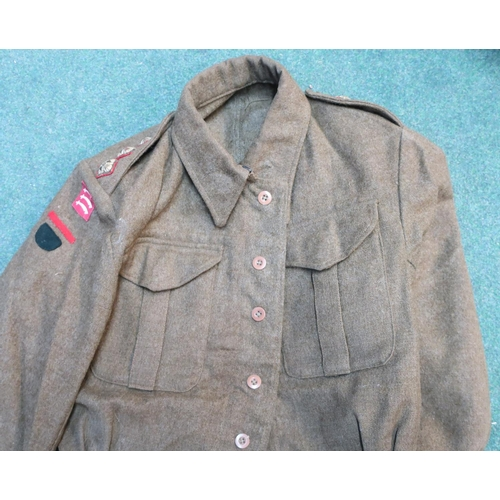 45 - Three WWII period battle dress blouses with various war department markings, one by Rego Clothers Lt...