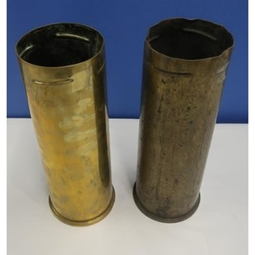10 - Pair of 105mm shell casings, one dated 1965...