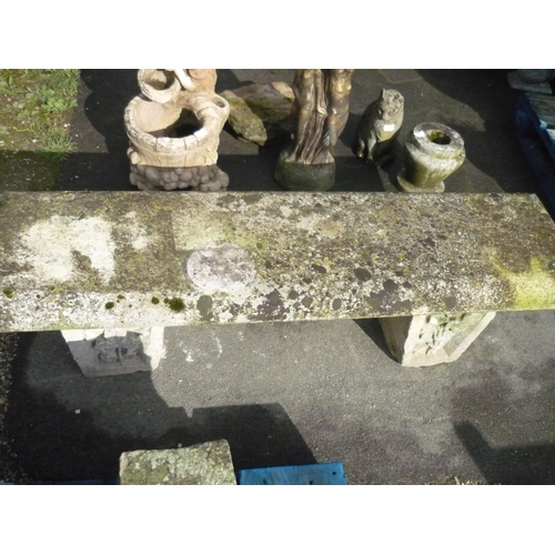 10 - Stone seat on carved floral supports (61