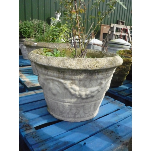 5 - Large reconstituted stone planter with fruiting vine decoration (diameter 31.5