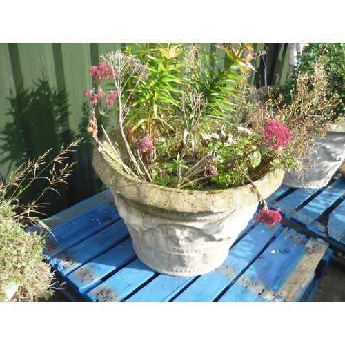 8 - Large reconstituted stone planter with fruiting vine decoration (diameter 31.5