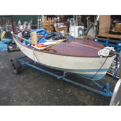 262 - Fishing dinghy (approx 11 feet long) with accessories including road trailer and launching trailer, ...