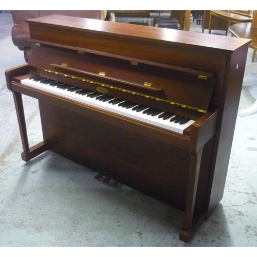 242 - Kemble of London mahogany cased upright piano, iron over strung, framed and numbered 268127 supplied...