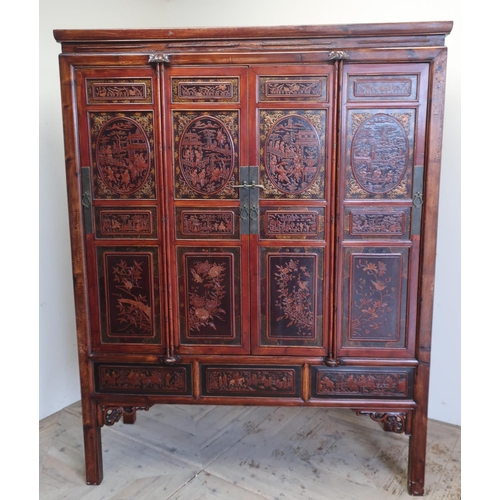 91 - Xi'An style lacquer wardrobe, the four panelled doors decorated with figures in pagodas and prunus b...