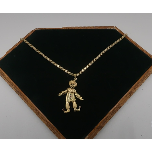 57 - Italian gold gem set articulated clown stamped N0314,  4.5cm, on 14kt gold flattened link chain, sta...
