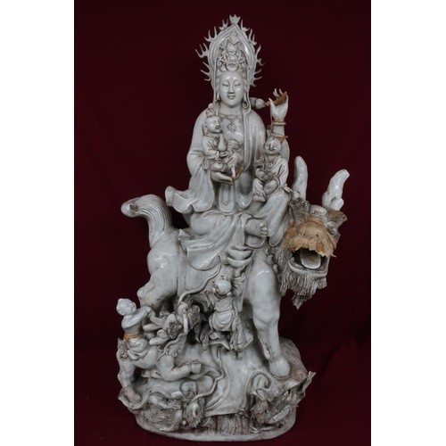 81A - Large blanc-de-chine model of a deity on an exotic animal, with four smaller attendant figures on a ...