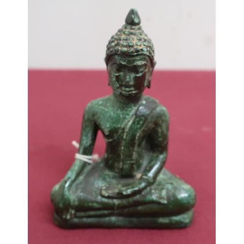 40 - Small Tibetan green patinated bronze model of a seated goddess, with gilt headdress (10cm)...