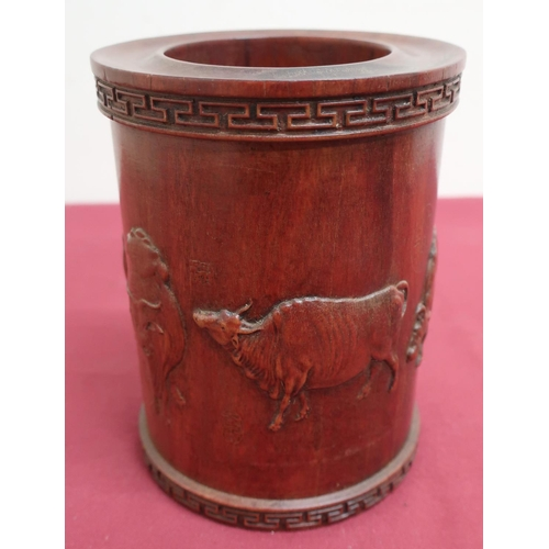 41 - Chinese hardwood cylindrical brush pot, relief carved with cattle and character marks, within a Gree...